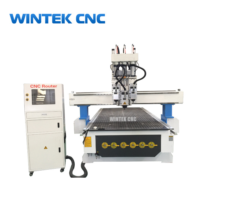 Three spindles automatic 3d wood carving cnc router for kitchen cabinet door